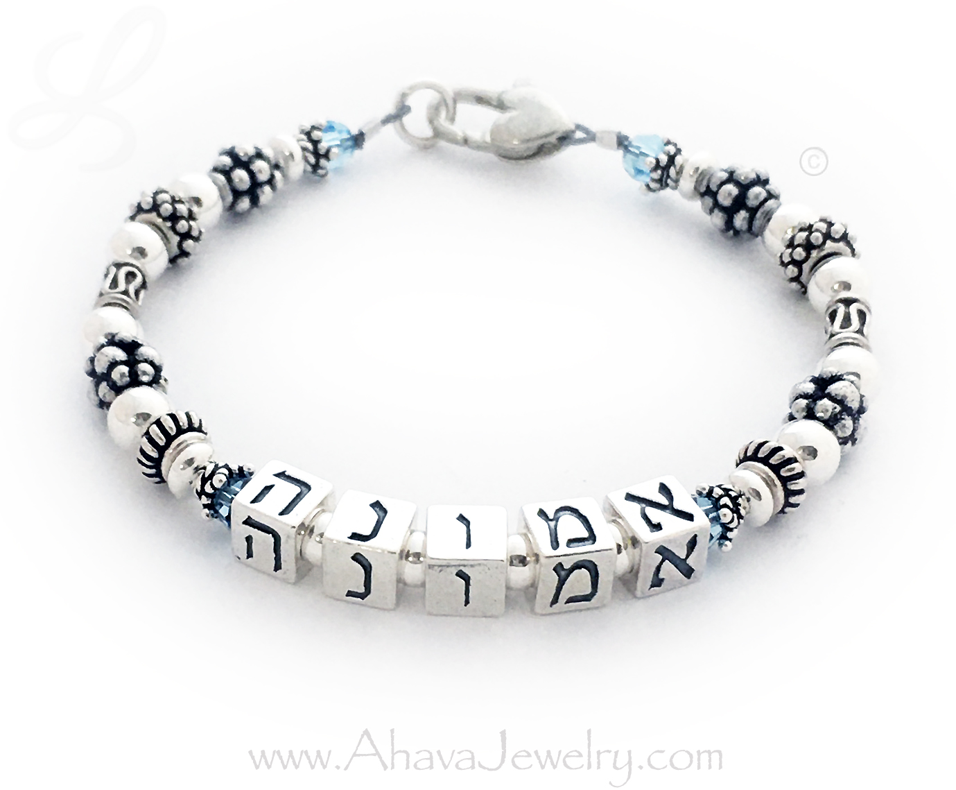 This bracelet says Emunah in Hebrew which means Trust in Hebrew. They added March Birthstone Crystals before and afteer Emunah and next to the clasp. They upgraded from the free lobster claw clasp to a Heart Lobster Claw Clasp.